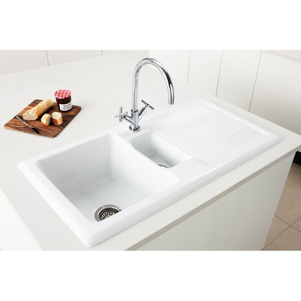 stunning design of the white kitchen sink with silver metal water