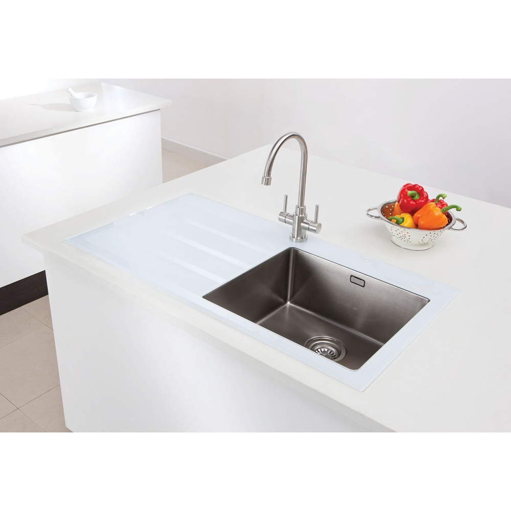 white kitchen sink. porcelain lighting for a lakeside cottage